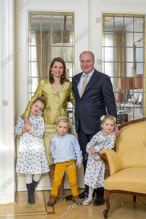 Prince Carlos of Bourbon-Parma and Princess Annemarie with Luisa Irene Constance Anna Maria Princess de Bourbon de Parme and Cecilia Maria Johanna Beatrix Princess de Bourbon de Parme and Prince Carlos Enrique Leonard de Bourbon de Parme during a family Christmas card photo session
