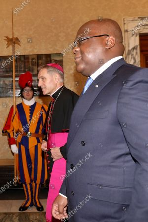 Stock Photo of The President of the Democratic Republic of the Congo Felix Antoine Tshisekedi Tshilombo with archbishop Georg Ganswein, Prefect of the Papal Household