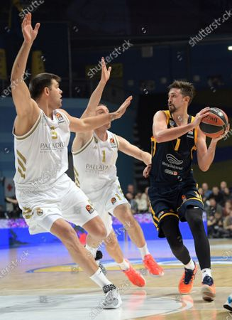 From left: Khimki's Alexey Shved, Real Madrid's Fabienne Coser and Rudy Fernandez during the match.