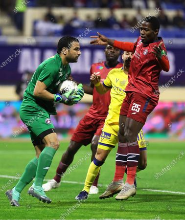 Al-Nassr's Giuliano Victor (2-R) in action against Al-Adalah players (L-R) goalkeeper Ayman Mathlouthi, John Ogu, and Sy Ass Mandaw (R) during the Saudi King's Cup quarter final socer match between Al-Adalah FC and Al-Nassr FC at Prince Abdullah bin Jalawi Stadium in Al-Ahsa, Saudi Arabia, 17 January 2020.