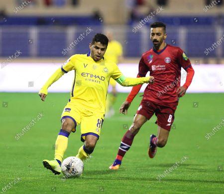 Stock Photo of Al-Nassr's Yahya Al-Shehri (L) in action against Al-Adalah's Abdullah Al Yousef (R) during the Saudi King's Cup quarter final socer match between Al-Adalah FC and Al-Nassr FC at Prince Abdullah bin Jalawi Stadium in Al-Ahsa, Saudi Arabia, 17 January 2020.