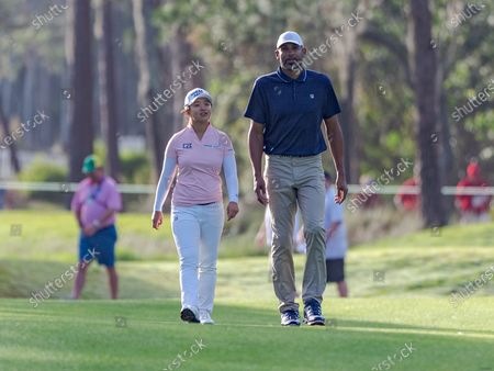 Lake Buena Vista, FL, U.S: Kim Sei-young of South Korea walks down the 2nd fairway with former NBA player Grant Hill during 2nd round of Diamond Resorts Tournament of Champions Presented by Insurance Office of America held at Tranquilo Golf Course at Four Seasons Golf and Sports Club Orlando in Lake Buena Vista, Fla