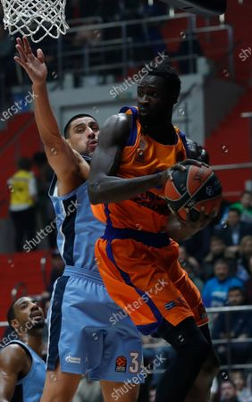 Maurice Ndour of Valencia Basket (R) in action against Gustavo Ayon of Zenit St. Petersburg (L) during the Euroleague basketball match between BC Zenit St. Petersburg and Valencia Basket Spain in St. Petersburg, Russia, 17 January 2020.