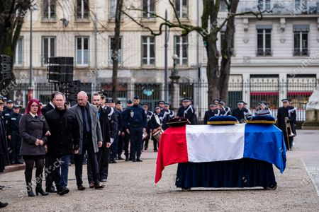 French Interior Minister Christophe Castaner and family members during an hommage ceremony in honour of Franck Labois