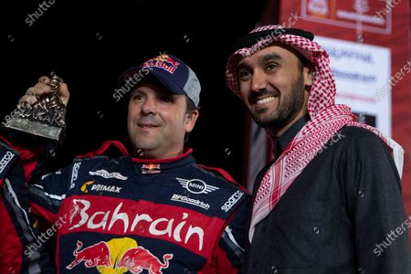 Stock Photo of Saudi General Sport Authority Chairman Prince Abdul-Aziz bin Abdullah bin Turki-Al-Faisal (R) poses for a photograph next to co-driver Paulo Fiuza (BAHRAIN JCW X-RAID TEAM) from Portugual after the last stage of the Rally Dakar 2020 in Qiddiya, Saudi Arabia, 17 January 2020.