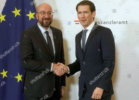 Austrian Chancellor Sebastian Kurz, right, welcomes President of the European Council Charles Michel, left, for a meeting at the federal chancellery in Vienna, Austria