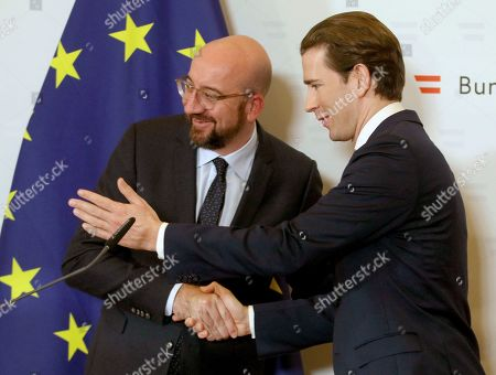 President of the European Council Charles Michel, left, and Austrian Chancellor Sebastian Kurz talk after a meeting at the federal chancellery in Vienna, Austria
