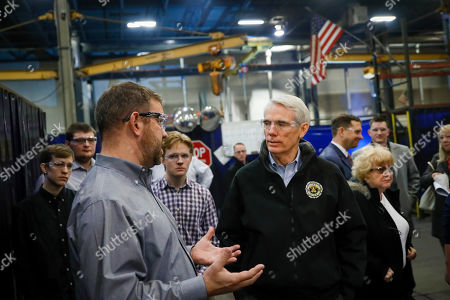 Sen. Robert Portman, R-Ohio, tours the Fecon manufacturing facility, a land preparation, lawn and garden equipment producer, in Lebanon, Ohio
