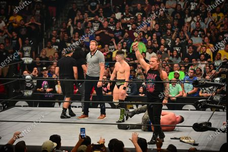 Stock Picture of Ortiz, Santana, Jake Hager, Sammy Guevara, Chris Jericho, of Inner Circles and Jonathan Good perform at the AEW Present Dynamite Bash At The Beach at Watsco Center at the University of Miami