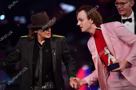 Actor Jan Buelow (R) and Singer Udo Lindenberg speak after Buelow was awarded best young actor during the Bavarian Film Awards (Bayerischer Filmpreis) ceremony at the Prinzregenten Theater in Munich, Germany, 17 January 2020.