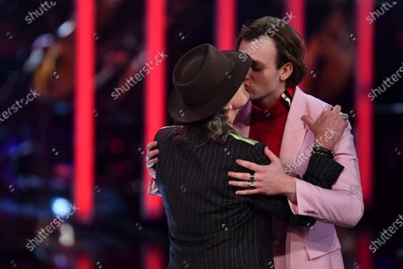 Stock Photo of Actor Jan Buelow (R) and Singer Udo Lindenberg kiss after Buelow was awarded best young actor during the Bavarian Film Awards (Bayerischer Filmpreis) ceremony at the Prinzregenten Theater in Munich, Germany, 17 January 2020.