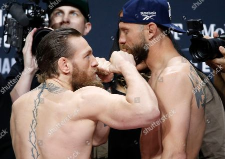 """Conor McGregor, left, and Donald """"Cowboy"""" Cerrone pose during a ceremonial weigh-in for a UFC 246 mixed martial arts bout, in Las Vegas. The two are scheduled to fight in a welterweight bout Saturday"""