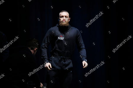 """Conor McGregor walks on stage during a ceremonial weigh-in for the UFC 246 mixed martial arts bout, in Las Vegas. McGregor is scheduled to fight Donald """"Cowboy"""" Cerrone in a welterweight bout Saturday in Las Vegas"""