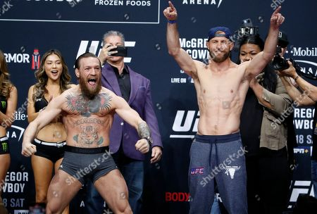 """Conor McGregor, left, and Donald """"Cowboy"""" Cerrone pose during a ceremonial weigh-in for a UFC 246 welterweight mixed martial arts bout, in Las Vegas. The two are scheduled to fight Saturday"""