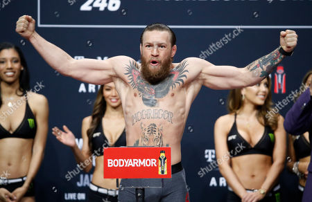 """Conor McGregor poses during a ceremonial weigh-in for the UFC 246 mixed martial arts bout, in Las Vegas. McGregor is scheduled to fight Donald """"Cowboy"""" Cerrone in a welterweight bout Saturday in Las Vegas"""