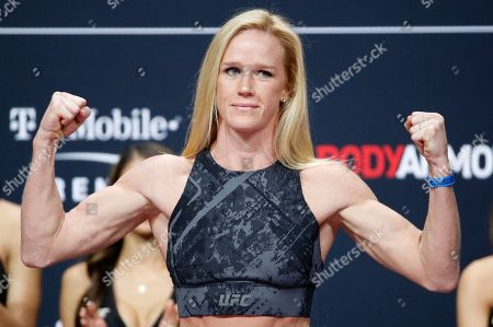 Holly Holm poses during a ceremonial weigh-in for the UFC 246 mixed martial arts bout, in Las Vegas. Holm is scheduled to fight Raquel Pennington in a women's bantamweight bout Saturday in Las Vegas