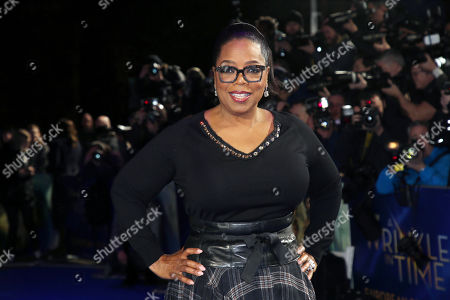 """Oprah Winfrey poses for photographers upon arrival at the premiere of the film """"A Wrinkle In Time"""" in London. Winfrey said, that Russell Simmons attempted to pressure her about her involvement with the documentary, """"On the Record,"""" in which several women detail sexual abuse allegations against the rap mogul, but his efforts were not what prompted her to leave the project"""