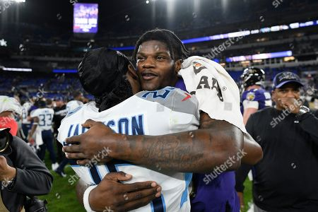 Baltimore Ravens quarterback Lamar Jackson (8) meets with Tennessee Titans cornerback Adoree' Jackson (25) after an NFL divisional playoff football game, in Baltimore. The Titans won 28-12