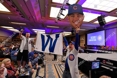 Chicago Cubs fans Paul Dzien, right, of Bartlett, Ill., and Mike Mitchell, of Lockport, Ill., celebrate during the baseball team's convention, in Chicago