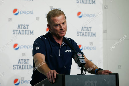 Dallas Cowboys head coach Jason Garrett takes part in a news conference following an NFL football game against the Washington Redskins in Arlington, Texas. A person with direct knowledge of the decision says New York is hiring Garrett to be the Giants offensive coordinator. The person spoke to The Associated Press on condition of anonymity, because the team did not immediately announce the move