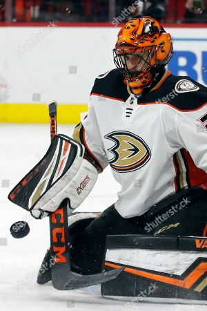 Anaheim Ducks goaltender Ryan Miller (30) defelects a shot during the second period of an NHL hockey game against the Carolina Hurricanes in Raleigh, N.C