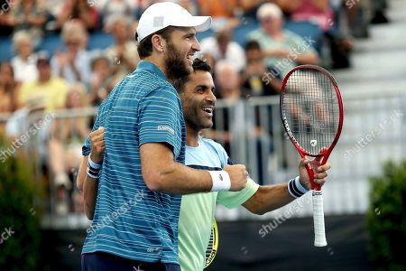 Maximo Gonzalez, Fabrice Martin. Argentine Maximo Gonzalez, right, and France's Fabrice Martin, left, celebrate their win over Croatian Ivan Dodig and Slovakian Filip Polasek during their Adelaide International tennis match in Adelaide