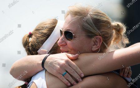 Antonia Lottner of Germany hugs Barbara Rittner after winning the final qualifications round at the 2020 Australian Open Grand Slam tennis tournament