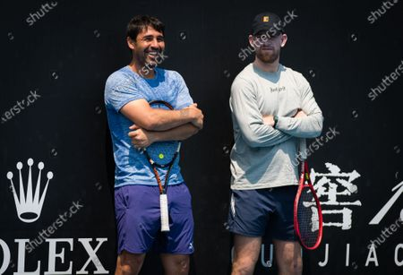 Marcos Baghdatis & Andrew Bettles watch Elina Svitolina during practice at the 2020 Australian Open Grand Slam tennis tournament