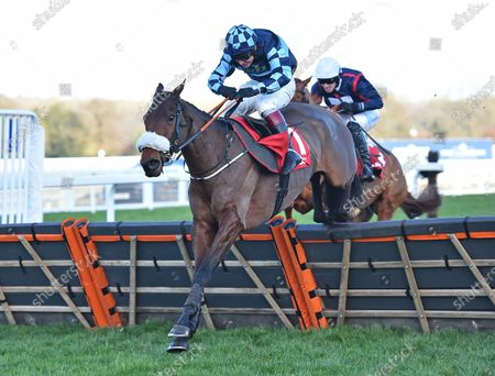 Thomas Darby (Richard Johnson) takes the last before going on to win The Matchbook Holloways Handicap Hurdle Race.