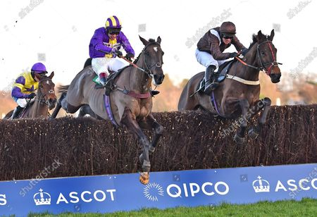 (R) Domaine De LIsle (David Bass) takes the last before going on to win The Bet365 Handicap Steeple Chase from in 3rd place (R) Kayf Adventure (Richard Johnson).