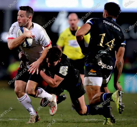 Ulster vs Bath Rugby. Ulster's John Cooney and Freddie Burns of Bath Rugby