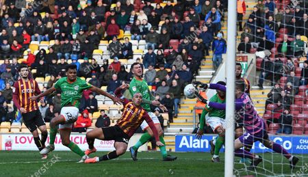 Stock Image of James Vaughan of Bradford City sees his header saved by Rory Watson goalkeeper for Scunthorpe United