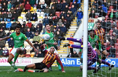 Stock Photo of James Vaughan of Bradford City sees his header saved by Rory Watson goalkeeper for Scunthorpe United
