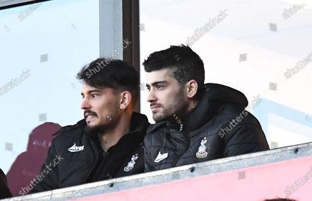Stock Photo of Zayn Malik from boy band One Direction watches Bradford City v Sculthorpe United