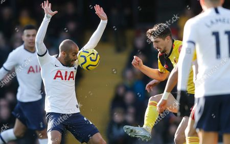 Stock Photo of Tottenham's Lucas Moura, left, challenges for the ball with Watford's Craig Cathcart during the English Premier League soccer match between Watford and Tottenham Hotspur at Vicarage Road, Watford, England