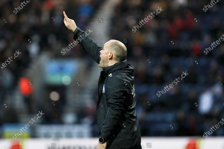 Stock Image of Preston North End manager Alex Neil gives instructions to the team  during the EFL Sky Bet Championship match between Preston North End and Charlton Athletic at Deepdale, Preston