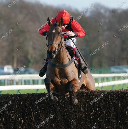 Haydock Park Racecourse The Patrick Coyne Memorial Altar Novices' Steeple Chase. Sam Brown ridden by Aidan Coleman clears the final fence to win.