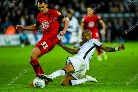 Andre Ayew of Swansea City tries to slide the ball through