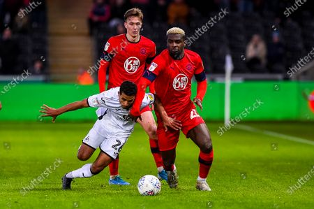 Stock Image of Kyle Naughton of Swansea City is brought to the floor