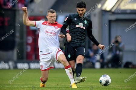 Duesseldorf's Oliver Fink (L) in action against Bremen's Nuri Sahin (R) during the German Bundesliga soccer match between Fortuna Duesseldorf and SV Werder Bremen in Duesseldorf, Germany, 18 January 2020.