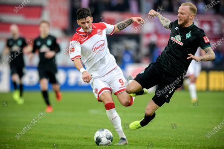 Duesseldorf's Dawid Kownacki (L) in action against Bremen's Kevin Vogt (R) during the German Bundesliga soccer match between Fortuna Duesseldorf and SV Werder Bremen in Duesseldorf, Germany, 18 January 2020.
