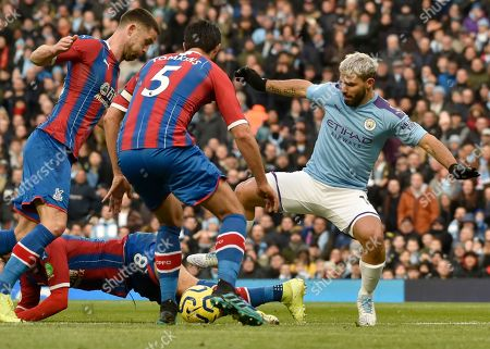 Manchester City's Sergio Aguero, right, duels for the ball with Crystal Palace's James McArthur, left, and Crystal Palace's James Tomkins during the English Premier League soccer match between Manchester City and Crystal Palace at Etihad stadium in Manchester, England