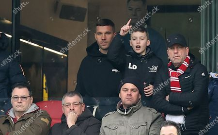 German soccer player Lukas Podolski and his son Louis watching the German Bundesliga soccer match between 1.FC Koeln and VfL Wolfsburg in Cologne, Germany, 18 January 2020.