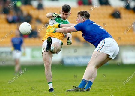 Stock Image of Offaly vs Longford. Offaly's Conor McNamee and Andrew Farrell of Longford