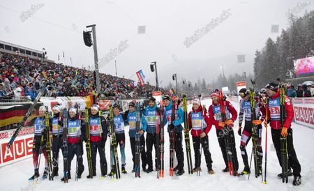 Vetle Sjaastad Christiansen of Norway (L-R), Tarjei Boe of Norway, Erlend Bjoentegaard of Norway, Johannes Dale of Norway, Quentin Fillon Maillet of France, Simon Desthieux of France, Martin Fourcade of France, Emilien Jacquelin of France, Felix Leitner of Austria, Simon Eder of Austria, Julian Eberhard of Austria and Dominik Landertinger of Austria celebrate after the men's 4x7,5 km relay race at the IBU Biathlon World Cup in Ruhpolding, Germany, 18 January 2020.