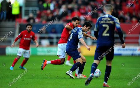 Korey Smith of Bristol City competes with Kenny Dougall of Barnsley-Mandatory by-line: Nizaam Jones/JMP
