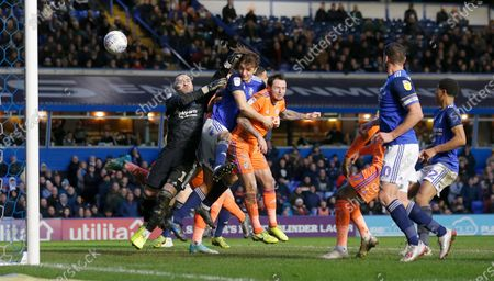 Lee Tomlin of Cardiff heads past Goalkeeper Lee Camp of Birmingham City to equal the score 1-1