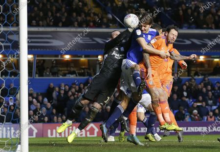 Stock Picture of Lee Tomlin of Cardiff heads past Goalkeeper Lee Camp of Birmingham City to equal the score 1-1