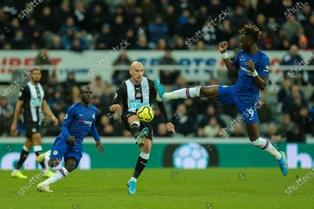 Jonjo Shelvey (#8) of Newcastle United controls the ball as Tammy Abraham (#9) of Chelsea attempts to block during the Premier League match between Newcastle United and Chelsea at St. James's Park, Newcastle