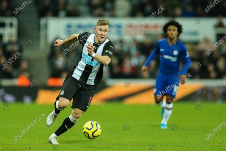 Stock Photo of Emil Krafth (#17) of Newcastle United in the ball during the Premier League match between Newcastle United and Chelsea at St. James's Park, Newcastle